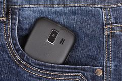 Part of cellphone in the pocket of blue jeans Royalty Free Stock Photography