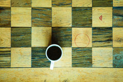 Part of chess old wooden table and coffee cup Stock Photography