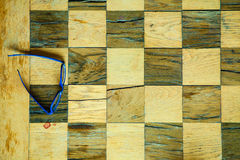 Part of chess old wooden table and glasses Royalty Free Stock Images