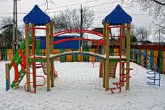 Colored empty playground under the snow on the street Stock Photography