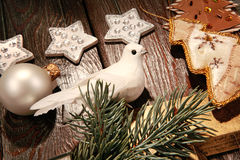 Part of a christmas. Photo of white pigeon near different christmas objects Stock Images