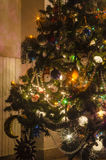 Part of the Christmas tree with lights and balls. In indoor royalty free stock image