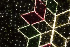 Part of the Christmas tree with star and lights royalty free stock photo