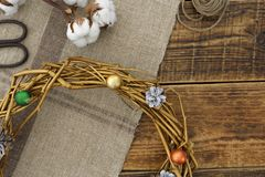 Part of a Christmas wreath painted in gold from natural materials. Decorating and items for creativity. Top view. Space under the text stock photos
