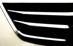 Part of chrome radiator of white modern car Stock Image
