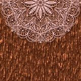 Part of a circular mandala ornament on a background of tree bark. Lace greeting card. Stock Photo