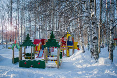 Part of the city Park for children. Children`s Playground in the winter snow Park Stock Photo
