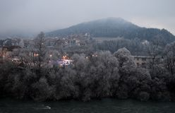 Part of the city by the river at dawn. Part of the city by the river in winter at dawn Stock Photography