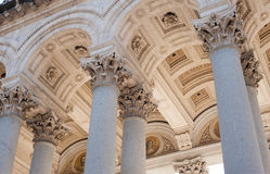 Part of classic architectural arch and colonnade. St Paul basilica in Rome, part of architectural arch and colonnade view from the ground Royalty Free Stock Image