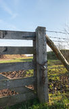 Part of a closed wooden gate in a rural landscape Stock Photo