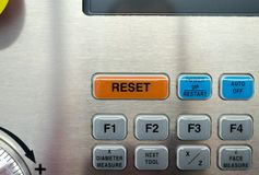 Part of CNC machine keyboard. The RESET button. Part of CNC machine keyboard. The RESET button on the CNC keyboard Stock Photos
