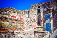 Part of the colored brick wall and street in Pompeii, Naples, It. Part of colored brick wall and street in Pompeii, Naples, Italy. The ruins of ancient city royalty free stock photos