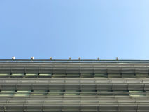Part of commercial building and blue sky Royalty Free Stock Photography