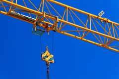 Part construction crane with blue sky background.  Stock Image