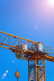 Part construction crane with blue sky background.  Stock Photo