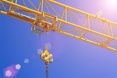 Part construction crane with blue sky background.  Royalty Free Stock Photography
