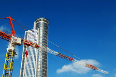 Skyscraper top & Crane Excerpt Stock Photography