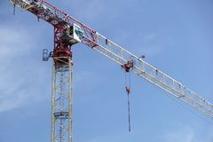 Part of a construction tower crane against the blue sky, copy space.  Stock Image