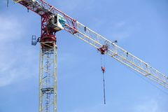Part of a construction tower crane against the blue sky, copy space.  Royalty Free Stock Photos