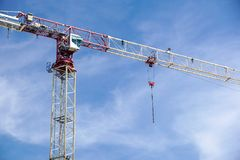 Part of a construction tower crane against the blue sky, copy space.  Royalty Free Stock Photo