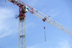 Part of a construction tower crane against the blue sky, copy space Stock Images