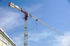 Part of a construction tower crane against the blue sky, copy space.  Stock Photo