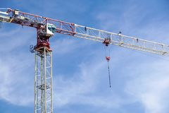 Part of a construction tower crane against the blue sky, copy space.  Stock Photos
