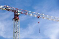 Part of a construction tower crane against the blue sky, copy space Royalty Free Stock Images