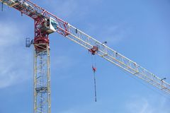 Part of a construction tower crane against the blue sky, copy space.  Royalty Free Stock Images
