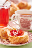 Part of croissant greased quince-cranberry jelly Royalty Free Stock Photo