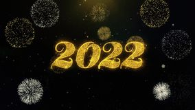 Part?culas escritas do ouro do ano novo feliz 2022 que explodem a exposi??o dos fogos de artif?cio