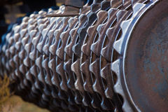 Part of the cultivator, steel, gear wheels in a row. Close-up. The work of agricultural machinery Stock Photos