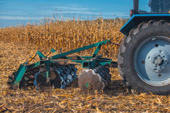 Part of the cultivator, steel, round discs in a row. Close-up. The work of agricultural machinery Royalty Free Stock Photo