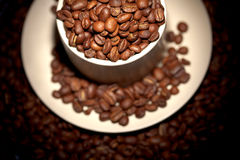 Part of cup full of hot coffee beans Stock Photo