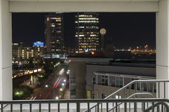 Part of the Dallas Skyline at night framed in a parking garage s Stock Images