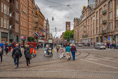 Part of Dam Square with pedestrians in center of Amsterdam at summer season Stock Photography