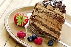 Part de gâteau de chocolat Images libres de droits