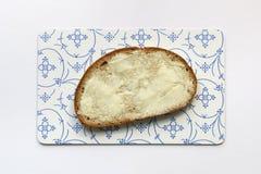 Part de pain avec du beurre Photos libres de droits