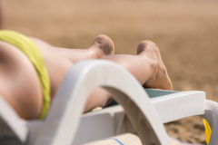 Part of the deck chairs on beach with legs Stock Photo