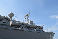 Part of the deck of a warship. communication devices and deck guns. Stock Photography