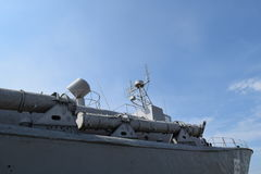 Part of the deck of a warship. communication devices and deck guns. Royalty Free Stock Photography