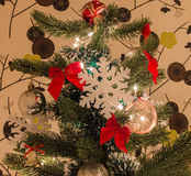 Part of decorated with big snow flake and red bows Royalty Free Stock Image