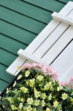 Part of decorated building window with flower Royalty Free Stock Photos