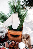 Part of decorated table served for two. Winter romantic picnic. Part of decorated table served for two covered with a blanket, standing in snow. Winter romantic Royalty Free Stock Photo