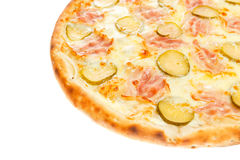 Part of delicious classic italian pizza with ham, sausages, corn, cucumbers and cheese Royalty Free Stock Image