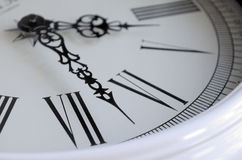 Part of the dial close-up. Sector dial clocks. Roman numerals. Curly metallic arrows Royalty Free Stock Image