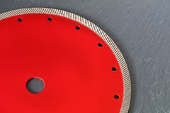 Part of a diamond cutting blade on a gray granite background. stock image