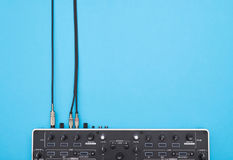Part of DJ mixer on blue background royalty free stock photography