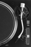 Part of dj turntable with tonearm Royalty Free Stock Photo