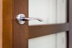 Part of door with silver door-handle royalty free stock photo
